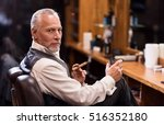 man sitting with cognac glass... | Shutterstock . vector #516352180