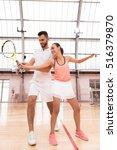 cheerful tennis instructor... | Shutterstock . vector #516379870
