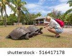 Female Tourist Woman Feeding...