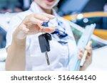 car keys. seller hand giving... | Shutterstock . vector #516464140
