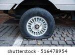 tire puncture | Shutterstock . vector #516478954