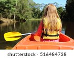 young girl paddle in small boat ... | Shutterstock . vector #516484738