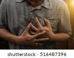 man having a heart attack. | Shutterstock . vector #516487396