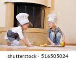 children in chef's hats near... | Shutterstock . vector #516505024