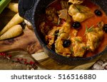 Stock photo baked rabbit in tomato sauce with rosemary top view 516516880