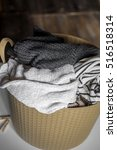Small photo of Laundry, warm clothes in the hamper, wash