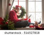 handsome young man with santa... | Shutterstock . vector #516527818