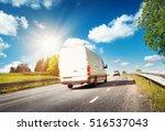 asphalt road on dandelion field ... | Shutterstock . vector #516537043