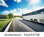 Small photo of Bus on asphalt road in beautiful spring day at countryside