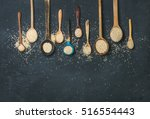 Stock photo quinoa seeds in different spoons over black stone background top view copy space superfood 516554443