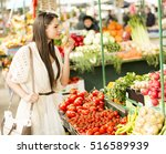 young woman buying vegetables... | Shutterstock . vector #516589939