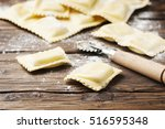 uncooked ravioli on the wooden... | Shutterstock . vector #516595348