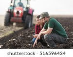 Young Farmers Examing Dirt...