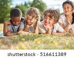 group of kids in summer smiling ... | Shutterstock . vector #516611389