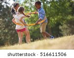 kids happily playing with hula... | Shutterstock . vector #516611506