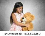 smiling little girl holding a... | Shutterstock . vector #516623350