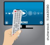hand holding a remote tv... | Shutterstock .eps vector #516630580
