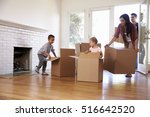 family unpacking boxes in new... | Shutterstock . vector #516642520