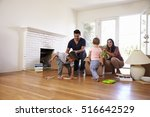 family unpacking boxes in new... | Shutterstock . vector #516642529