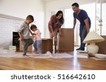 family unpacking boxes in new... | Shutterstock . vector #516642610