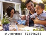 family at home eating outdoor... | Shutterstock . vector #516646258