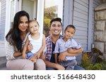 portrait of family sitting on... | Shutterstock . vector #516648430