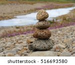 stacked lava stones in balance | Shutterstock . vector #516693580
