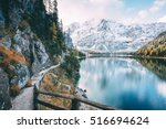 great alpine lake braies ... | Shutterstock . vector #516694624