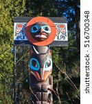 Small photo of VANCOUVER, CANADA -DECEMBER 8, 2013: A Haida Indian totem pole stands in the forest of Stanley Park, marking the boundary with the spirit world.