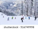 skiers and snowboarders riding... | Shutterstock . vector #516749998
