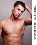 muscled male model posing in... | Shutterstock . vector #51675082