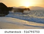 waves splash at stones on shore ...   Shutterstock . vector #516793753