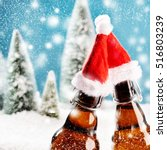Two Xmas Beer Bottles Clink...