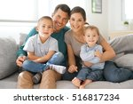 happy family of four sitting on ... | Shutterstock . vector #516817234