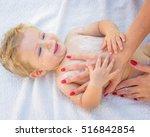 Mother Hands Applying Cream On...