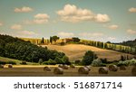 fields with hay bales in the... | Shutterstock . vector #516871714