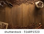 coffee beans on wooden... | Shutterstock . vector #516891523