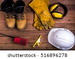 Small photo of Standard construction safety equipment on wood background