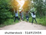 asian girls were jumping on the ... | Shutterstock . vector #516915454