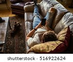 bearded guy relaxing on couch... | Shutterstock . vector #516922624