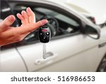 dealer hand with a car key. | Shutterstock . vector #516986653