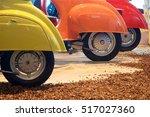 three rear wheels in a line.... | Shutterstock . vector #517027360
