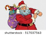 santa claus shows on the clock  ... | Shutterstock .eps vector #517037563