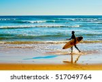 surfer with surfboard walking... | Shutterstock . vector #517049764