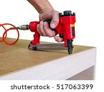 red sroiteny pneumatic stapler | Shutterstock . vector #517063399