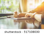 young girl writing into her... | Shutterstock . vector #517108030