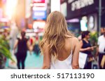 stylish blonde woman walking... | Shutterstock . vector #517113190