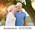 senior couple relaxing in park | Shutterstock . vector #517179190