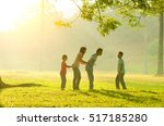 asian family walking outdoor in ... | Shutterstock . vector #517185280