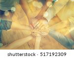 group of diverse hands together ... | Shutterstock . vector #517192309